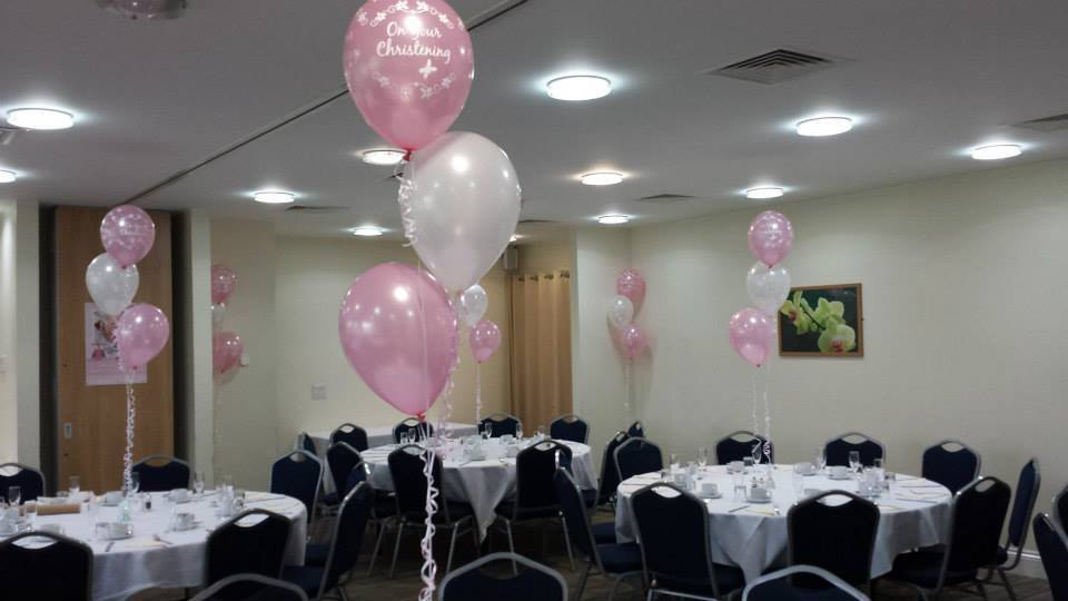 Pink and grey balloon clusters table centrepiece